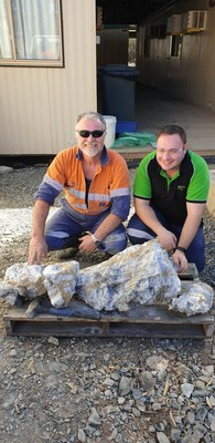 Figure 1: Mine Foreman Warren Edwards (Left) and Senior Mine Geologist Zafirios Thanos (Right) with some of the 274 kg of rock containing visible gold from a blast on 16 L South A Zone drive at Beta Hunt Mine. (CNW Group/RNC Minerals)