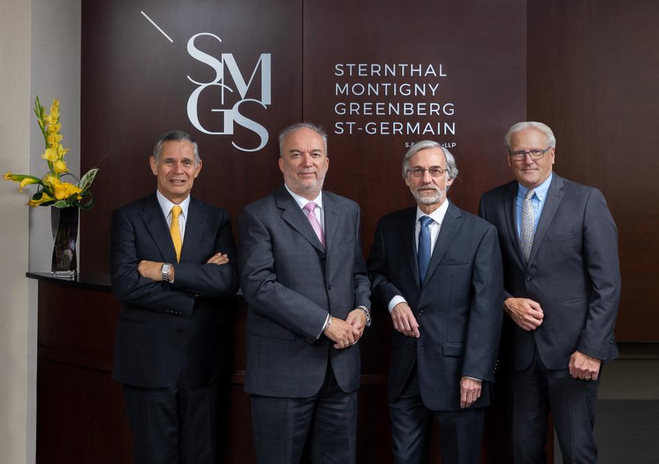 The four longstanding partners of the firm: David Sternthal, Jean Montigny, Leon Greenberg and Guy St-Germain, standing in front of their new visual identity. (CNW Group/Sternthal Montigny Greenberg St-Germain s.e.n.c.r.l.)