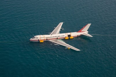 An aerial shot of the aircraft during the process of being submerged