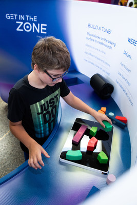 A visitor finds his flow as he uses different building blocks to create a song, while visiting MindWorks at the Ontario Science Centre. This psychology exhibition runs to April 26, 2020. (CNW Group/Ontario Science Centre)