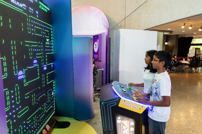 Visitors play the world's largest Pac-Man game, but not before using their negotiating skills to make a deal. MindWorks, a psychology exhibition, runs to April 26, 2020 at the Ontario Science Centre. (CNW Group/Ontario Science Centre)