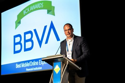 BBVA USA eBanking Channels Mobile Product Manager Gilbert Strickland accepts the Best Mobile/Online Experience award in Chicago.
