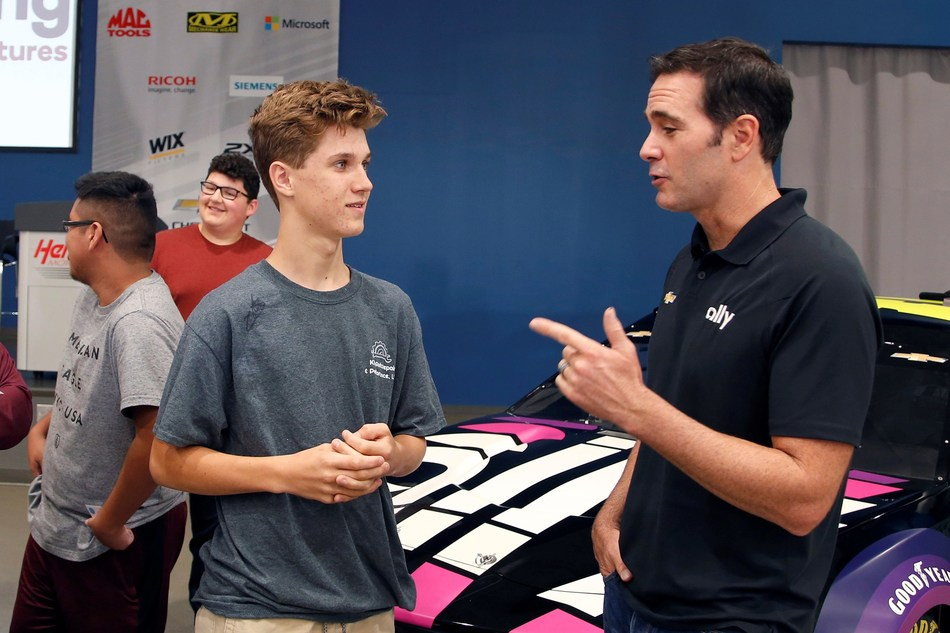 Jimmie Johnson and his sponsor Ally Financial introduced students to motorsports careers and money basics during the Ally Fueling Futures event at Hendrick Motorsports