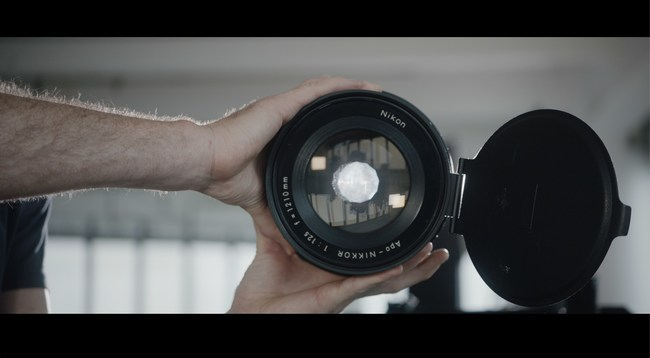 Brendan Barry holds large format lens used in the Skyscraper Camera Project