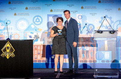 Amy Sheehan, director of talent acquisition at Hormel Foods, accepting the award at the event.