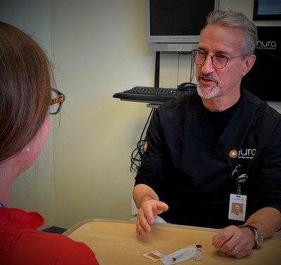 Peter Schultz, MD, Nura trains a patient on the use of Narcan.