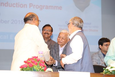 Hon'ble Minister of State, MHRD, Shri Sanjay Shamrao Dhotre and AICTE, Chairman, Anil Sahasrabudhe congratulating Advocate Shri S. K. Jain, Chairman, Managing Council, S. P. Mandali and Local Managing Committee, WeSchool and Prof. Dr. Uday Salunkhe, Group Director, Welingkar Institute of Management (WeSchool)
