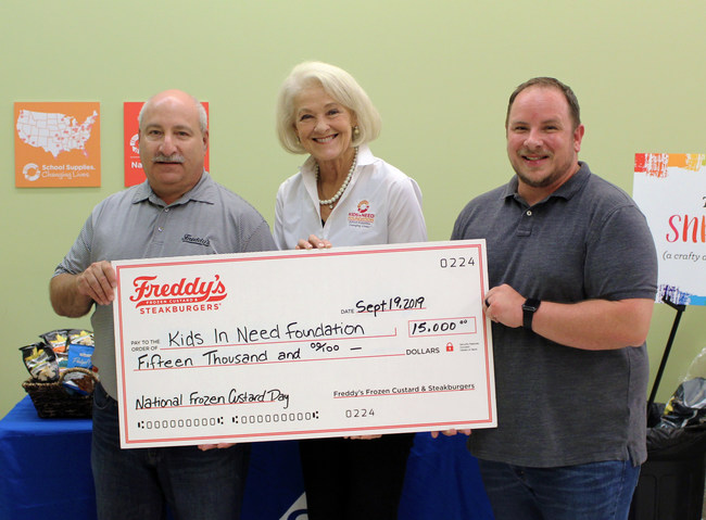 Scott Redler, COO & Co-Founder, Freddy's Frozen Custard & Steakburgers presenting the donation check to Kristine Cohn, Senior Director of Development & Corporate Partnerships, Kids In Need Foundation and Terry Johnson, Director & Founder of Project Teacher.