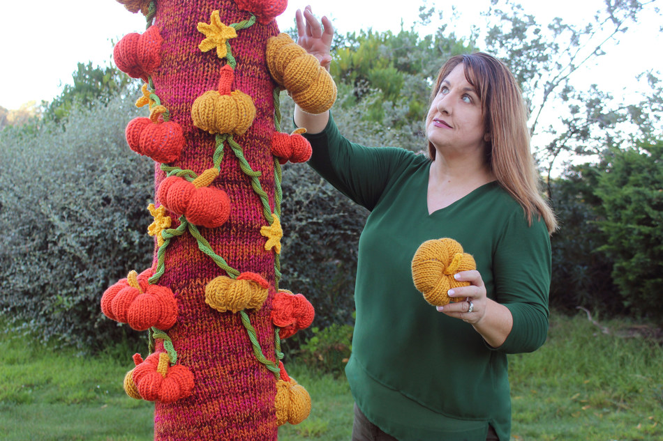 """YouTuber Kristen McDonnell from """"Studio Knit"""" Exhibits Pumpkin Patch Forest with Yarnbombed Trees at Salesforce Park in San Francisco, California October 19 - 31, 2019."""