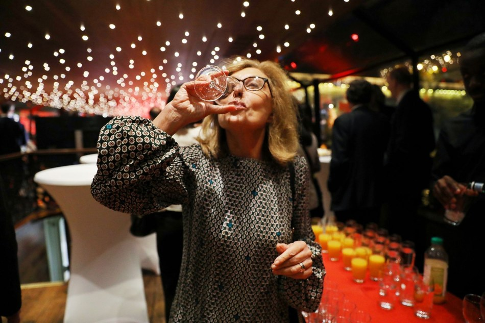 Martine Partrat, an executive from Air France, is tasting the Wuliangye wine.
