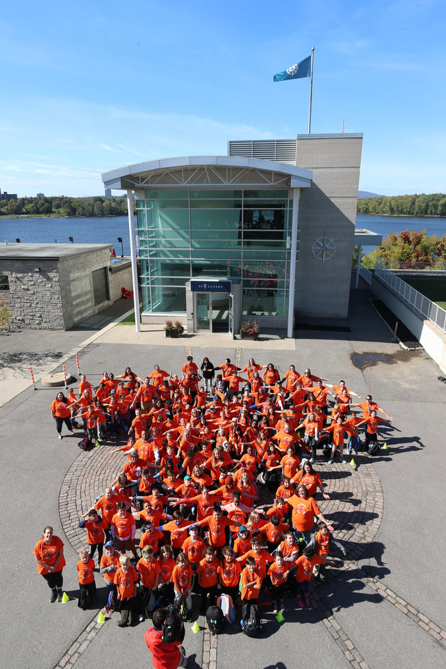 At the headquarters of the Royal Canadian Geographical Society, students from the National Capital Region assemble to form a giant orange shirt, as part of a day long educational event to mark Orange Shirt Day. Photo: Abtin Kargari/Canadian Geographic (CNW Group/Royal Canadian Geographical Society)