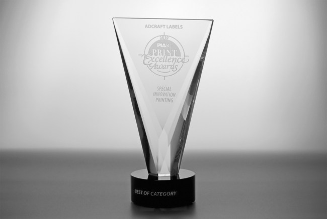 The Special Innovation Award, pictured here, is one of three Best of Category awards won by Adcraft Labels at the 2019 Print Excellence Awards competition. For the first time in the event's history, one label entry earned three different Best of Category awards. The one label was created with Adcraft's proprietary 3-D printing technology, the next generation of lenticular printing. The process allows images and colors to shift, show depth, and create optical movement on the labels.