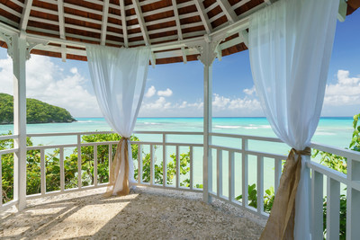 Couples Sans Souci Cliffside Oceanfront Gazebo. Intimate wedding parties of up to 8 guests luxuriate in panoramic views of the Caribbean.