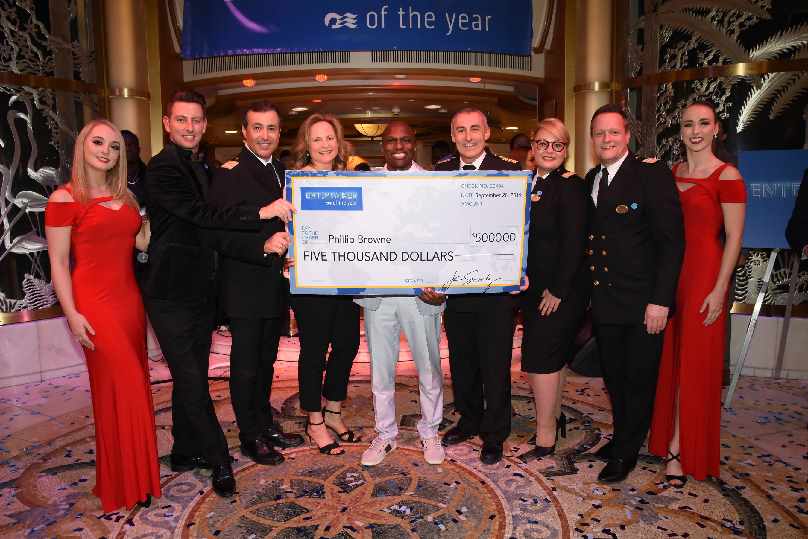 Vocalist Phillip Browne (center) was named Princess Cruises newest Entertainer of the Year onboard Star Princess on September 28, 2019