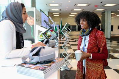 A member of the SDRPY delegation (left) describes the program's development initiatives to a visitor at UN headquarters in New York.