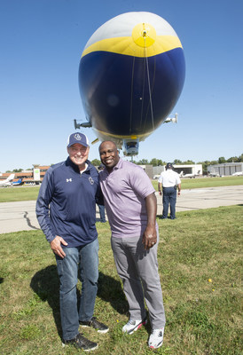 College Football Hall of Fame inductee London Fletcher and his high school and college coach Mike Moran before boarding the Goodyear Blimp for a ride over Cleveland, Friday Sept. 27, 2019 in Cleveland. (Phil Long/AP Images for Goodyear)