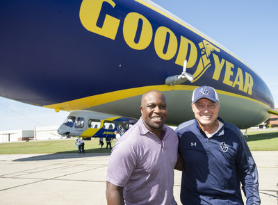College Football Hall of Fame inductee London Fletcher and his high school and college coach Mike Moran following their surprise reunion and ride on the Goodyear Blimp over Cleveland, Friday Sept. 27, 2019 in Cleveland. (Phil Long/AP Images for Goodyear)