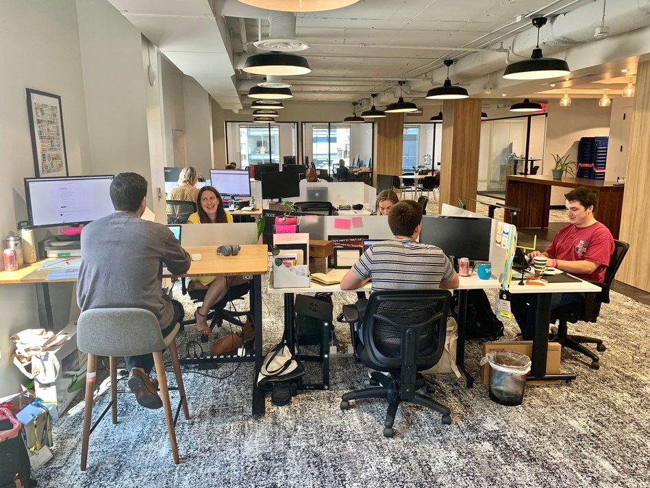 Employees working out of the new TransitScreen headquarters at 750 17th St NW in downtown Washington, DC.