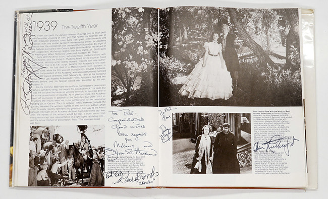 Two pages from Robert Osborne's personal copy of the 1979 book he authored titled 50 Golden Years of Oscar®: The Official History of the Academy of Motion Picture Arts and Sciences. Book contains 383 autographs of Oscar winners and nominees. Pages shown here were signed by stars of Gone With The Wind. Provenance: The Robert Osborne Collection, then by family descent. Estimate: $20,000-$30,000