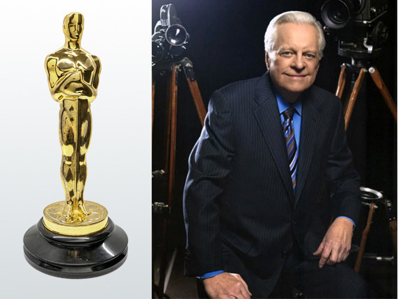 """The late Robert Osborne and the """"star"""" of his collection, the 1936 Oscar® statuette awarded to art director Richard Day for his work on the 1935 film The Dark Angel, starring Fredric March and Merle Oberon. Provenance: The Robert Osborne Collection, then by family descent. Auction estimate: $70,000-$100,000"""