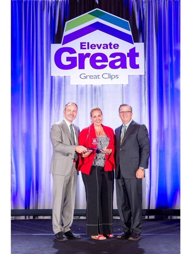 Gretchen Blake, VP of Business Development, receiving the '2019 Vendor of the Year' award with CEO Steve Hockett, and President Rob Goggins.