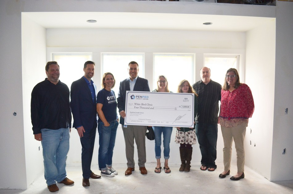PenFed Credit Union employees present a $4,000 donation check to White Bird Clinic staff at their new dental clinic construction site at 1415 Pearl Street, Eugene, Oregon.