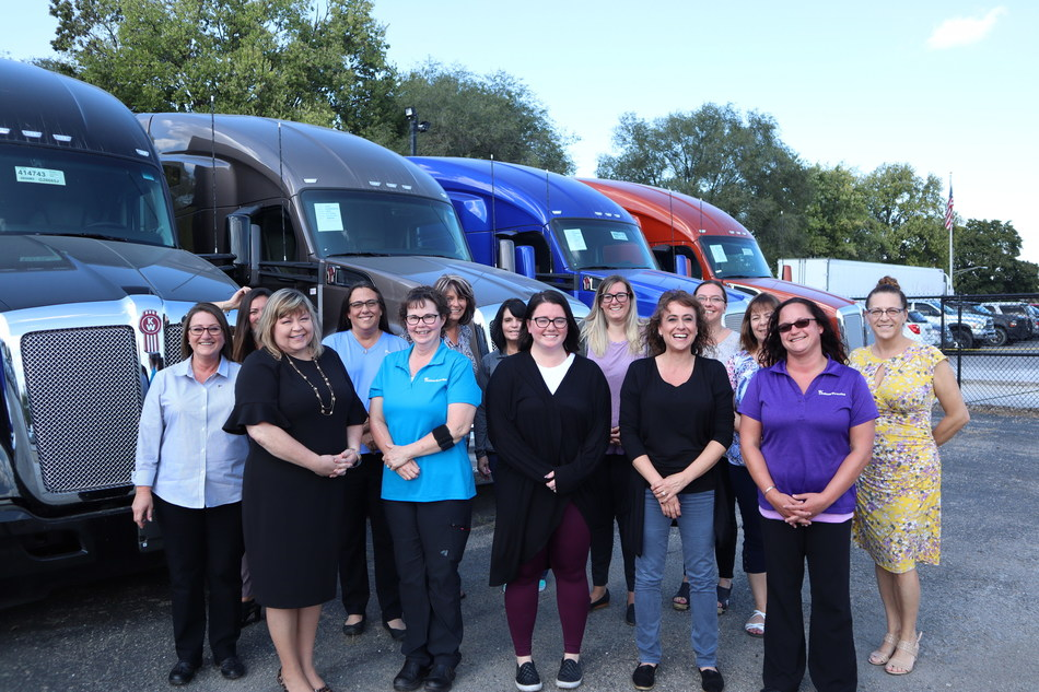 The ladies at Kenworth of Indianapolis pose as a team with new Kenworth trucks in the background. Kenworth of Indianapolis was the first dealership of Palmer Trucks and was established by Eldon Palmer in the 1970s. The dealership has been home to several, stellar female employees throughout the decades.
