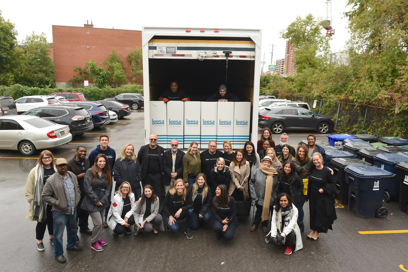 Teams from Hudson's Bay, Leesa Sleep and CMHA gather to deliver mattresses to residents at a CMHA housing complex in Toronto on October 3, 2019. (CNW Group/Leesa Sleep, LLC)