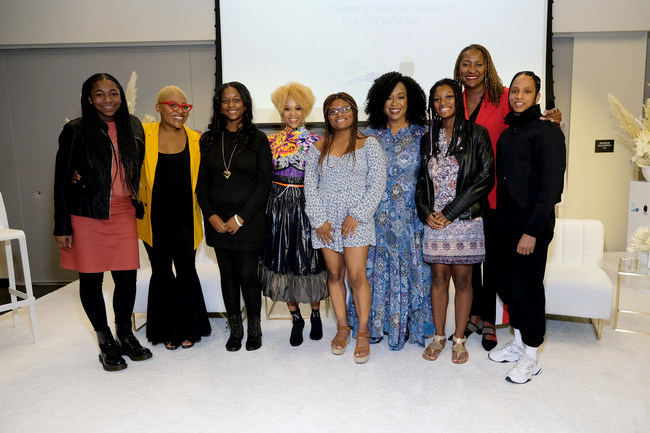 "Faith Fennidy, Tyrelle Davis, Esi Eggleston Bracey, Deanna Cook, Shonda Rhimes, Mya Cook, Senator Holly Mitchell, and Janaya ""Future"" Khan attend a town hall discussion centered on the impact of hair discrimination hosted by The Dove Self-Esteem Project. (Photo by Sarah Morris/Getty Images for Dove)"