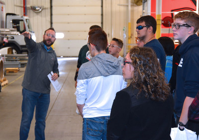 Spartan Motors' Production Supervisor Collin Seigle guides students from Charlotte High School's STEM program around Spartan Motors headquarters in Charlotte, Michigan.