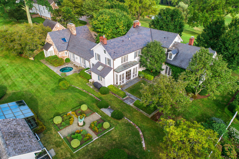 The main residence (built in 1894 and renovated to include all modern conveniences) offers 5 beds, 5 full and 2 half baths. Many rooms open to bluestone terraces offering impressive views of the bucolic countryside, lush paddocks and manicured grounds. NewJerseyLuxuryAuction.com.
