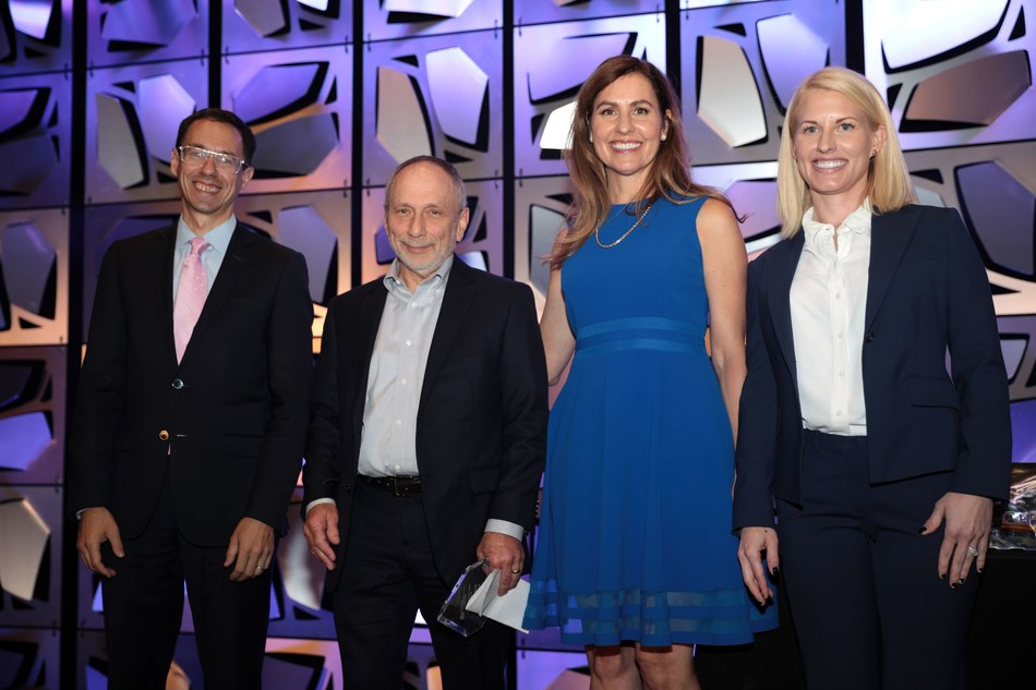 Interface CEO Joel Strom (second from left) Accepts Manufacturer of the Year Award