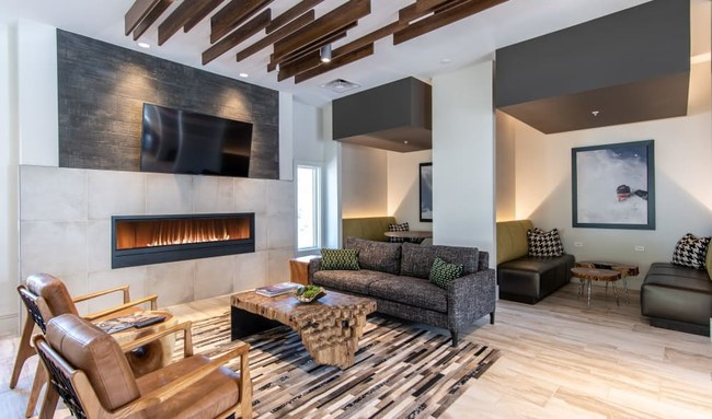The 120-unit community features one, two, and three-bedroom units with a large community clubhouse designed in a fresh, modern mountain aesthetic.