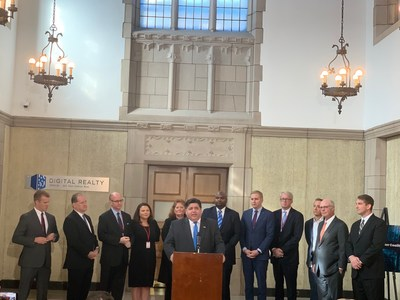 Illinois Governor J.B. Pritzker addresses a coalition of state legislators and local leaders to commemorate newly enacted data center tax incentives
