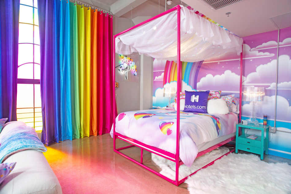 The Hotels.com Lisa Frank Flat is complete with a technicolor rainbow window display, a light-up canopy bed and Instagram-worthy wall mural