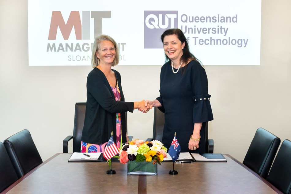 From left to right: Kris Schaefer, Senior Associate Dean of MIT Sloan School of Management, and Robina Xavier, Executive Dean of QUT Business School, kick off a five-year collaboration between the two schools with a signing ceremony held on the MIT Sloan campus. Photo credit: Justin Knight