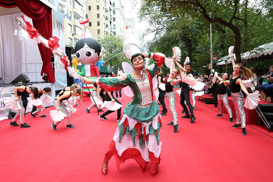 "Simona Rodano (""The Italian Fairy"") performs on the red carpet stage at the Columbus Day Parade"