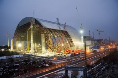 The New Safe Confinement arch was assembled in sections near the damaged reactor and slid into place on rails. Photo credit: European Bank for Reconstruction and Development