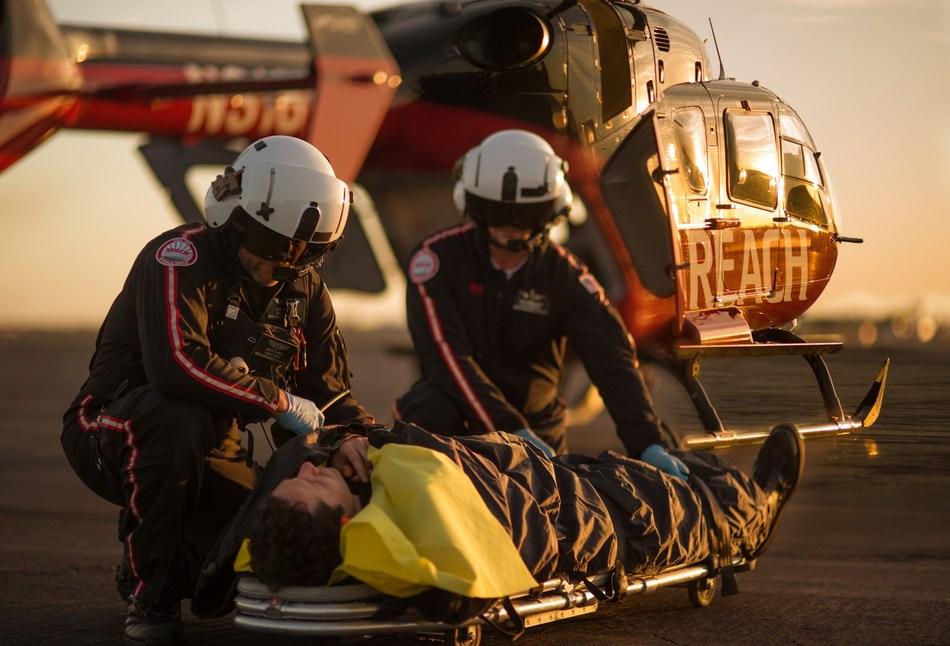 Air medics deliver critical care to a patient requiring air ambulance assistance.