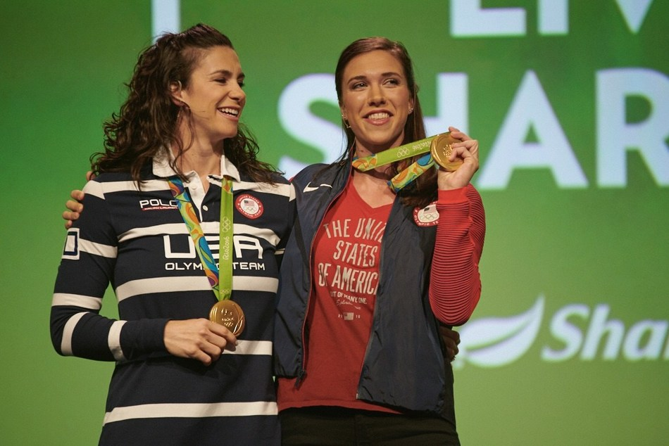 Gold medal rowers Amanda Polk and Amanda Elmore onstage at the Shaklee Global Conference.