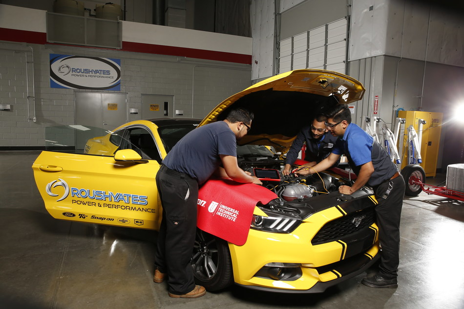 Students work on a high performance engine during their Roush Yates Power & Performance course, which is part of UTI's core automotive program