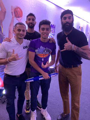 Arnav Sethi posing with few players before the NBA India Games