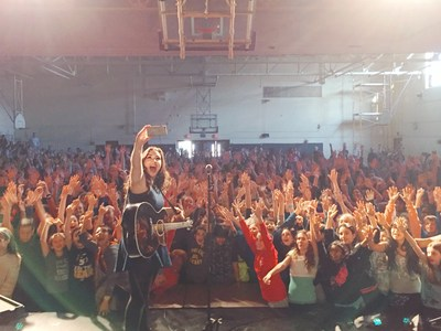 Casey poses for a selfie with students during a 'You Matter' Tour performance.