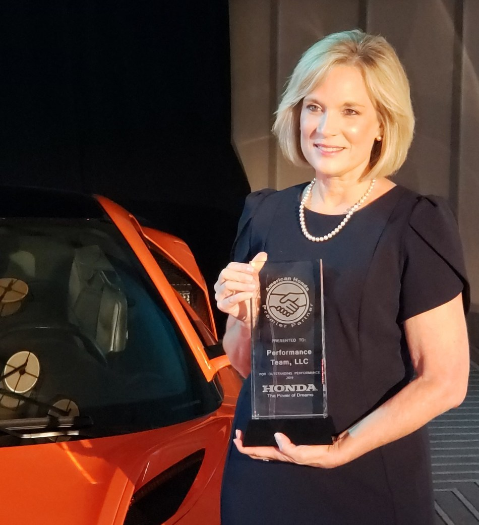 Performance Team Director of Operations Sonya Medlin receives the 2019 American Honda Premier Partner award for outstanding performance.