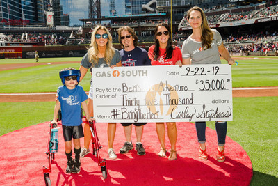 "Cleo ""Link,"" Kristin Klingshirn and Molly Darby accepted the check from Gas South's Carley Stephens at the Atlanta Braves game on September 22. (Photo by is Kevin D. Liles)"