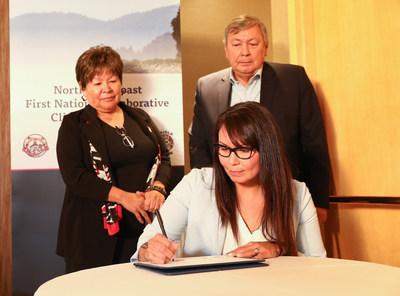 Signing: Crystal Smith, Chief Councillor, Haisla Nation Behind: Eva Clayton, President, Nisga'a Nation; John Helin, Mayor, Lax Kw'alaams Band; (CNW Group/Lax Kw'alaams Band)