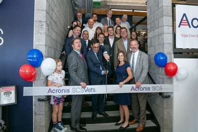 (Front, LtoR) Congressman Greg Stanton, Acronis SCS CEO John Zanni, Arizona Senator Martha McSally, and Scottsdale Mayor Jim Lane, lead the ribbon cutting ceremony to officially open Acronis SCS headquarters in Scottsdale, Ariz. The event included the announcement of SCSVets, an initiative to provide at least 300 veterans, active duty military, and military spouses with the credentials, skills, and resources necessary to pursue a cybersecurity career.