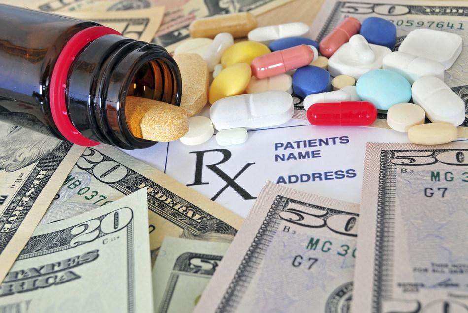 Close up photo of prescription pills and money