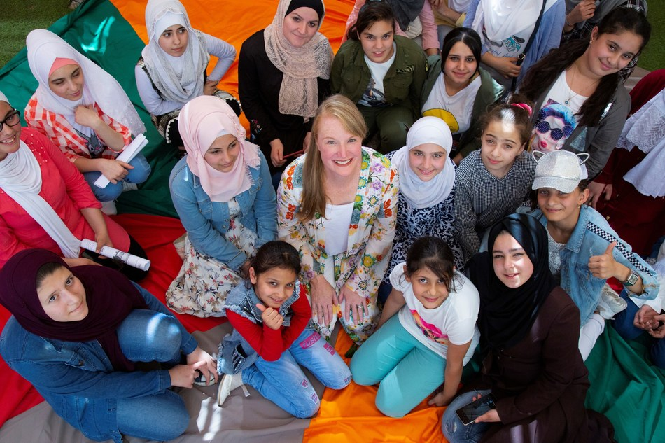 Olivela founder Stacey Boyd visits young female students sent to school in Jordan through Olivela's philanthropic efforts.