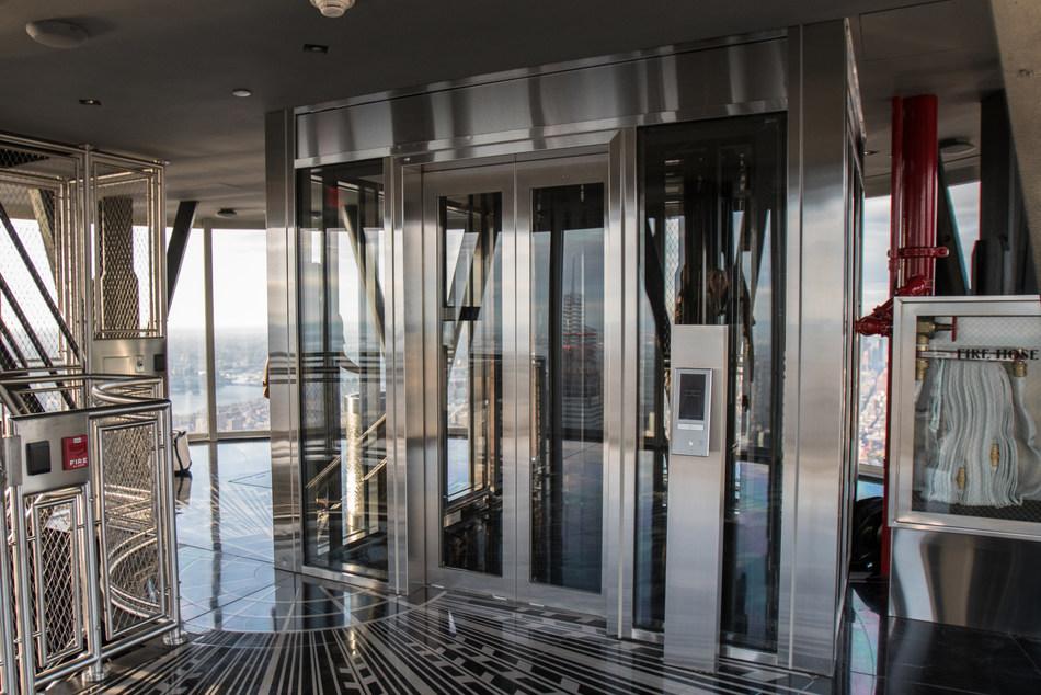 The 102nd floor landing also includes glass hoistway walls